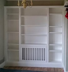 Built In Shelving Unit With Integrated Radiator Cover